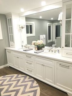 Master Ensuite with custom vanity; like the round rug