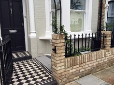 classic 100mm balck and white victorian mosaic tile path yellow brick garden wall metal garden rail rose arch fulham putney chelsea london