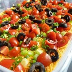 7 LAYER TACO DIP...Tomato, Green Onion, Black Olives, Cheddar Cheese, Sour Cream, Re-fried Beans & Shredded Lettuce...Serve with Nachos