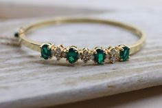 14K Vintage Diamond and Emerald gold bangle by TheHavenFinds