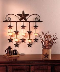 Metal Wall Sconce CandleholderLight your home with the country charm of the Rustic Star Home Decor. The Metal Wall Sconce Country Wall Decor, Rustic Decor, Rustic Barn, Western Kitchen Decor, Western Style, Candle Holder Decor, Star Decorations, Primitive Decorations, Candle Wall Sconces