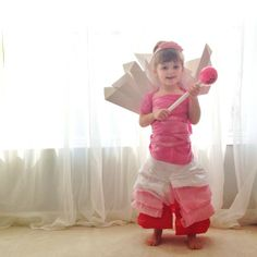 Little Girl and Her Stylish Paper Dresses