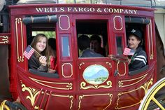 Happy campers in the Well's Fargo stage coach in the Good Old Days Parade at The Good Old Days Celebration and Music Festival - it features over 100 entries. The Festival includes the County's largest arts and crafts show, with over 200 art and food vendors in downtown Pacific Grove, a parade down Pine Avenue, over 75 live entertainers on five stages, and lots of family fun - kids fair, carnival rides and games, and more! www.pacificgrove.org