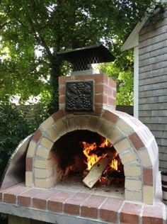 A beautiful color combo on this Red & Tan Wood Fired Brick Pizza Oven!  This oven was built using the Mattone Barile DIY Brick Pizza Oven Form.  To see more pictures of this oven (and many more ovens), please visit – BrickWoodOvens.com