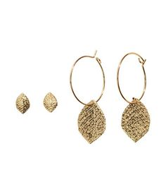 2-pack earrings in gold-tone metal with leaf-shaped decorations. One pair of small studs and one pair of hoops. | H&M Accessories