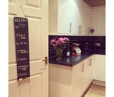 A tall, thin hanging chalkboard with a pre-printed 'MEMO' heading and the days of the week. A great addition to your kitchen. Kitchen Blackboard, Hanging Chalkboard, Christmas Gift Guide, Blackboards, Kitchen Cabinets, Home And Garden, Home Decor, Kitchen Chalkboard, Restaining Kitchen Cabinets