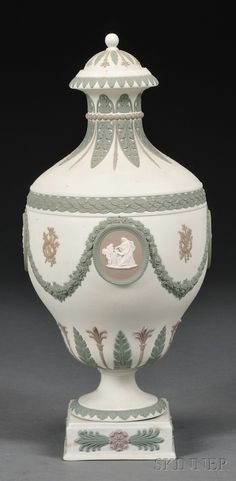 Wedgwood Three-color Jasper Vase and Cover, England, late 19th century, white ground with lilac, white, and green relief including foliate borders, classical medallions, floral garland, and trophies.
