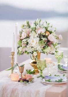 pastel floral centerpiece - photo by Julia Kaptelova http://ruffledblog.com/romantic-santorini-elopement