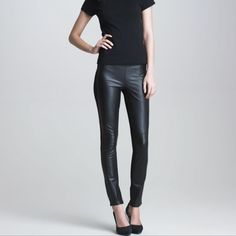 "Paige Denim || Black Paloma Faux Leather Legging Sleek faux-leather panels glisten against the front of stretchy ponte-knit leggings for moto-inspired edge. 30"" inseam; 10"" front rise; 14"" back rise. Elasticized waistband. 54% polyurethane, 46% polyester with 65% rayon, 30% nylon, 5% elastane contrast. Dry clean. By Paige Denim; imported. t.b.d. Use hip measurement to determine size. Narrow through the thigh. Snug fit; will stretch with wear. Paige Jeans Pants Leggings"