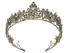 A GEORGE III DIAMOND TIARA   Designed as a series of foliate scrolls, the central panel with stylized plume surmount set throughout with rose-cut diamonds to the closed-back setting, mounted in silver and gold, circa 1790, frame 45.5 cm. Click to enlarge: http://assets3.pinimg.com/upload/137641332332945950_4mojokLU.jpg