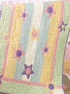 Free Baby's Stars Quilt Pattern Download from Freepatterns.com.