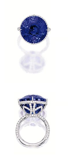 SAPPHIRE AND DIAMOND RING. Centring on a round sapphire weighing 29.30 carats, to a mount decorated by circular-cut diamonds extending to the shoulders, mounted in platinum.