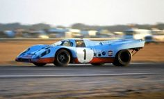 The #1 Gulf Porsche 917 of Jo Siffert and Derek Bell coming into the old turn three at the 1971 24 Hours of Daytona. Jo Siffert was the number one driver for Porsche and more than any other driver helped in the early stages of the 917's development. He was tragically killed just weeks after this picture was taken in a Formula one accident while driving for BRM. More than 50,000 showed up for his funeral in Switzerland and a Gulf Porsche 917 with John Wyer led the procession.
