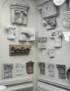 A COLLECTION OF SEVEN PLASTER CAPITALS AND ARCHITECTURAL FRAGMENTS