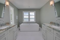 Owners Bath: ceramic tile floor, granite counters, painted cabinets, dual vanity, stand-alone soaking tub, natural light.