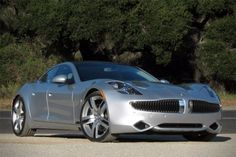 Almost Zero... 2012 KARMA REVEALED BY FISKER.. Two  x 200hp rear mounted electric engines supplemented by a gasoline engine only when necc.