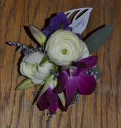 Dendrobium orchids and ranunculus boutonniere