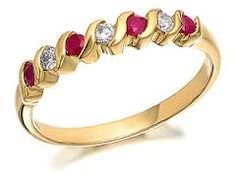 Image result for ruby and opal eternity ring