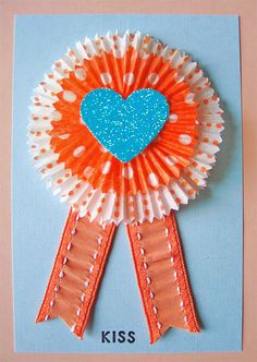 DIY Cupcake Liner Card. Use mom's favorite colors. Combine the cupcake liners with silk (round) flower petals for a softer look.