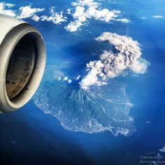 Opened my window shade while flying over Japan, noticed a volcano was erupting. (OC) - Imgur