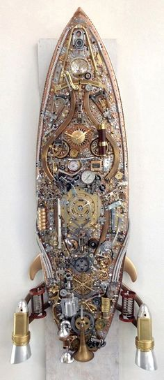 Steampunk Surfboard.  I might need to see if my brother has an unusable board for me to do this to.