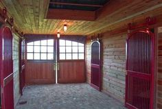 Luxury equestrian features include stable comfort mattress system, automatic waterers, and brick paved center aisles.