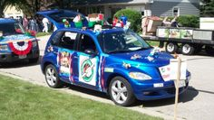 Operation Christmas Child decorated car for parade.