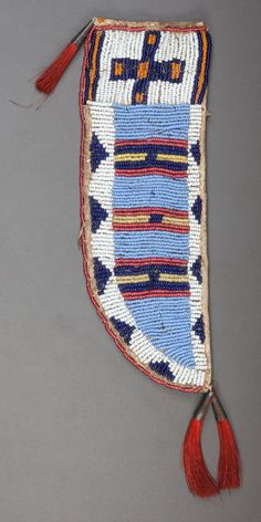 American Indian Art:Beadwork and Quillwork, A SIOUX BEADED HIDE KNIFE SHEATH. c. 1890