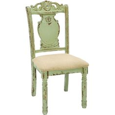 Weathered wood side chair in green and cream with an upholstered seat. Includes turned leg design and a scrolling garland accent.  Product...
