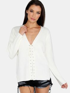 """We are loving this crossed knit! Featuring a plunging v neckline, eyelet lace up detailing and knitted material. Sweater measures 24.8"""" in. from top to bottom hem. Team with a cami and medium washed ankle jeans. #autumn #sweaters #tops #MakeMeChic #MMCstyle #ootd #MMC #style #fashion #newarrivals #summer16"""