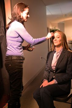 Dr. Emma getting touched up for a segment of The Dr. Oz Show