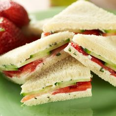 Layers of strawberry and cucumber between slices of bread.