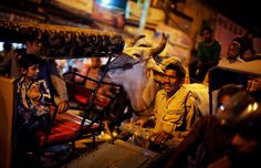 An Indian laborer with a push cart meant for ferrying goods tries to make his way through a crowded street at a whole sale market in New Delhi, India, Monday, March 31, 2014. (AP Photo/Altaf Qadri)