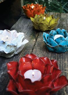 a lotus flower emerging from a murky pond. Lotus Candle Holder, Glass Candle Holders, Ceramic Flowers, Clay Flowers, Tea Light Candles, Tea Lights, Christmas Tree Candle Holder, Pottery Designs, Tea Light Holder