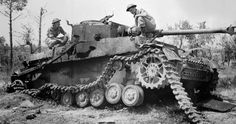 German Panzer IV tank, examined by Lance-Bombardier T. Hallam and Signalman A.H. Wharf, HQ, RCA, 5th Canadian Armoured Division, near Pontecorvo, Italy, 26 May 1944.