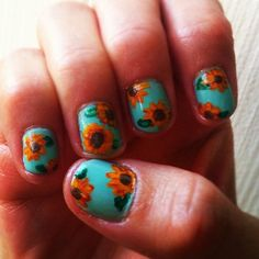 @pamsandkins sunflowers on turquoise nail polish could brighten anyones day. #nailcall Nail Art