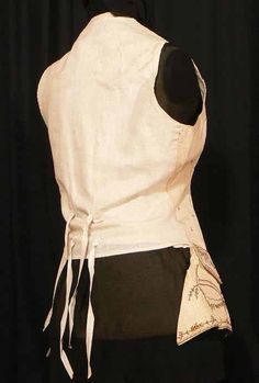 1770s French Rococo Ladies' embroidered silk waistcoat. This piece is shorter at the back to accommodate the skirt and longer front.