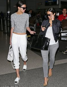 Kim Kardashian and Kendall Jenner coordinated their monochrome looks at LAX airport http://dailym.ai/1oqm9k9