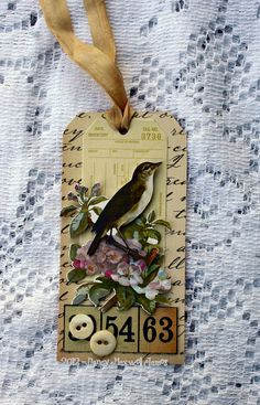 Handmade vintage-style layered tag featuring 3-D songbird embellishment, buttons, seam binding