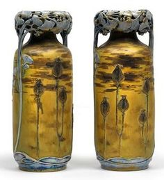 Attributed to Paul Dachsel, A pair of vases with molded ginkgo leaves and painted poppies, designed in about 1894/95, executed by Amphorawerke Riessner, Stellmacher & Kessel, Turn-Teplitz, ceramic, with polychrome, gold and relief decoration, gilding slightly smudged, one vase with cracking, underside marked, height 32.5 cm