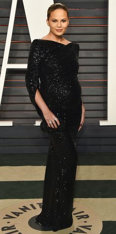 Chrissy Teigen won best maternity style at the Oscars after-party, too, thanks to an impossibly elegant off-the-shoulder black sequined Talbot Runhof gown