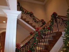 A Whole Bunch Of Christmas Staircase Decorating Ideas - Christmas Decorating -http://blog.styleestate.com/christmas-decorating/2012/11/14/a-whole-bunch-of-christmas-staircase-decorating-ideas.html