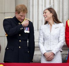 Prince Harry and Catherine, Duchess of Cambridge watch the fly-past from the balcony of Buckingham Palace during Trooping the Colour, Queen Elizabeth II's Birthday Parade on June 14, 2014 in London.