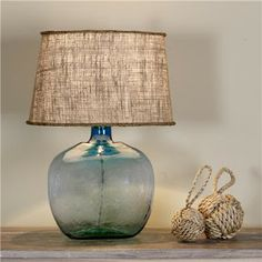Glass lamp with burlap shade.