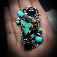 """Hope everyone had a beautiful holiday season and a blessed new year thus far and continuing forward! A new ring available ready to be claimed and sized (DM for inquiries): """"Reawaken Rhythm""""- As the New Year begins and the seasons change, we are reawakened and renewed to the rhythms of life.  This ring features Nicola Jane turquoise center surrounded by onyx, and kingman turquoise in blue and green. #silversmith #metalsmith #instasmithy #turquoiseoverdiamonds #turquoise #southwest #blessed…"""
