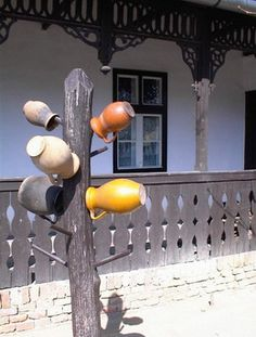 farmhouse with colourful pots in Hungary