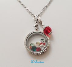 Clear Diamond Crystal Locket with swarovski crystals a snowman, a wreath and cherries charms with a red dangle. Perfect for a holiday gift