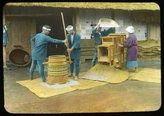 Husking the grains by hand mill, and winnowing them Enami Studio Lantern Slide No : 562. About 1920's, Japan