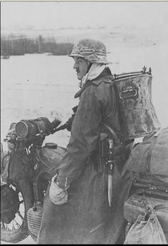 kruegerwaffen: German soldiers on a motorcycle BMW with food thermos on the road during the Battle of Moscow.