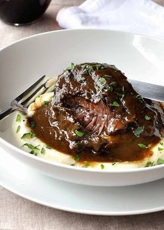 Slow cooked beef cheeks in red wine sauce on creamy mashed potato